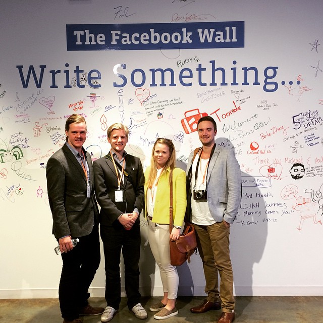 The winners infront of the physical facebook wall